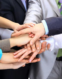 Hands piled on top Royalty Free Stock Photo