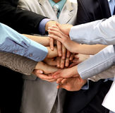 Hands piled on top. Of one another stock photography