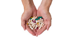 Hands with pills and drug Stock Photo