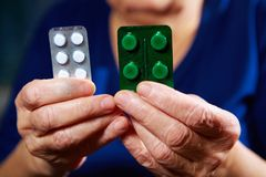 Hands with pills Royalty Free Stock Photos