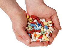 Hands with pills Royalty Free Stock Image