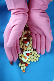 Hands with pills and gloves Stock Photos