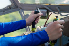 Hands pilot at wheel the airplane Royalty Free Stock Photography
