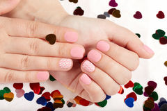 Hands with pink matte manicured nails Royalty Free Stock Image
