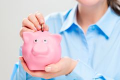 Hands with a pink piggy bank close-up royalty free stock photo