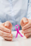 Hands and a Pink Ribbon Royalty Free Stock Image