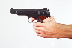 Hands with pistol on white background Stock Photos