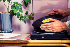 Hands placing LP on turntable stock images