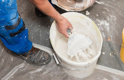 Hands plasterer at work Stock Photos
