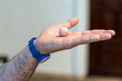 Hands with plasticine ball. Royalty Free Stock Photo