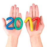 Hands with plasticine figures Stock Photo