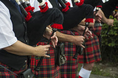 Hands play the bagpipes Stock Photos