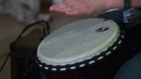 Hands play drums at musical concert, live sound, tapping rhythm. Stock footage stock video