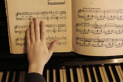 Hands play piano close up photo royalty free stock images