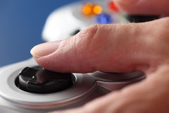 Hands play video game using a gamepad Royalty Free Stock Images
