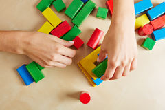 Hands playing with building blocks Stock Photos