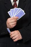 Hands and playing card in sleeve Royalty Free Stock Photo