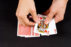 Hands and playing cards Royalty Free Stock Photos