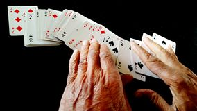 Hands and playing cards Stock Photos