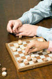 Hands Playing Chess stock photos