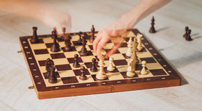 Hands playing chess with motion ghost effect Stock Images