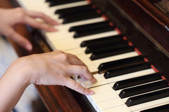 Hands playing the classic wood  piano Royalty Free Stock Photos
