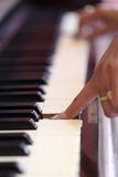 Hands playing the classic wood  piano Royalty Free Stock Photography