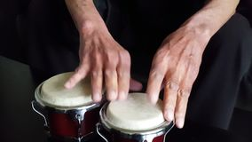 Hands playing conga drums stock video