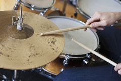 Hands Playing Drum Set. Closeup of hands playing drum set Stock Images