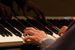 Hands Playing Grand Piano Keys Tight Shot Stock Image