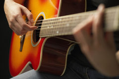 Hands Playing Guitar Royalty Free Stock Images