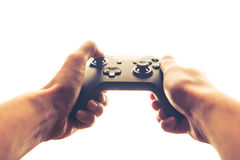 Hands playing joystick. White background Royalty Free Stock Image