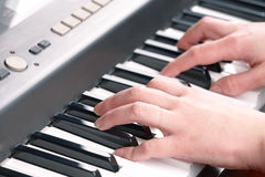 Hands playing music on the piano Royalty Free Stock Photos