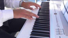 Hands playing music on the piano, hands and piano player, keyboard stock video