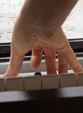 Hands playing music on the piano Royalty Free Stock Image
