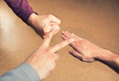 Hands playing paper rock scissors Royalty Free Stock Photography