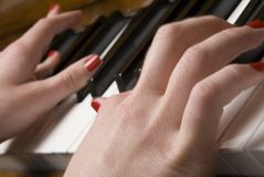 Hands playing piano Stock Photography