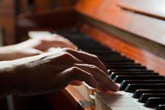 Hands playing the piano Stock Images