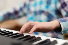 Hands playing the piano (close-up) Royalty Free Stock Image