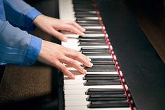 Hands playing the piano Stock Image