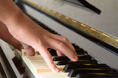 Hands playing piano Stock Photos