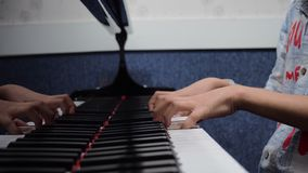 Hands playing piano royalty free stock photo