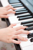 Hands playing piano Stock Photo