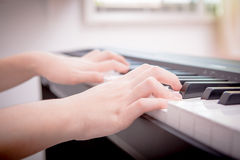 Hands playing piano Stock Image