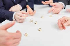 Hands playing roll the dice Stock Photos