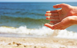 Hands playing with sand Stock Photography