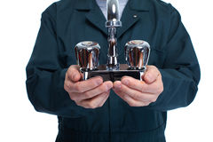 Hands of plumber with water tap. royalty free stock images