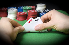 HANDS with pocket aces Royalty Free Stock Photo