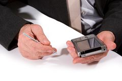 Hands with pocket pc stock photo