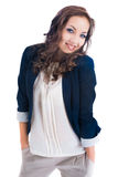 Hands in pockets. Young female with hands in pockets in blue jacket isolated on white Stock Photos